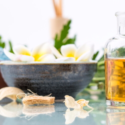 Essential oils and scrubs for a spa treatment.