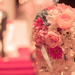 A wedding bouquet in the foreground of a chapel.
