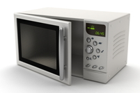 A white microwave, ready for use.