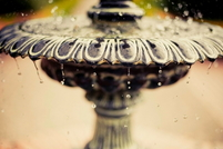 A cast iron fountain bubbling over with water.