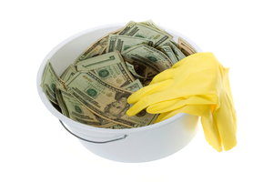 A white bucket with yellow gloves and cash.