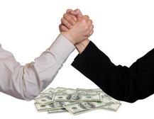 People arm wrestling over money