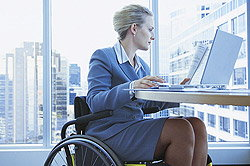 Woman in a Wheelchair at a Desk