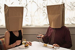 Man and woman on a date with paper bags