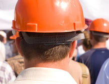 Man in a hard hat at a rally