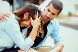 Woman cries as she struggles with her relationship
