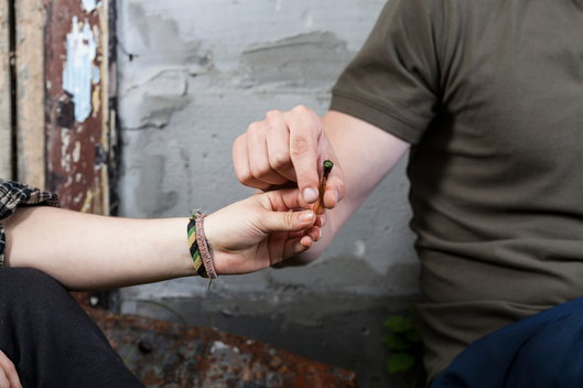 two teens passing a joint