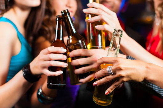 girls holding beer bottles at a party
