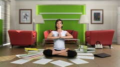 A mom meditating while surrounded by paper work.