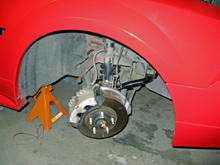 heres a good look at the new spring installed...and you can see the front sway bar as well.