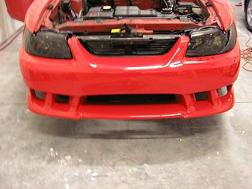 Front bumper paint work all done, also had the headlights smoked out.