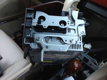 Side view of original head unit with door attached removed from dash.