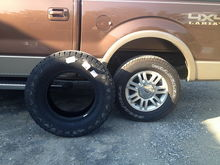 Nitto Terra Grappler 295/70/18 next to stock Wrangler 275/65/18