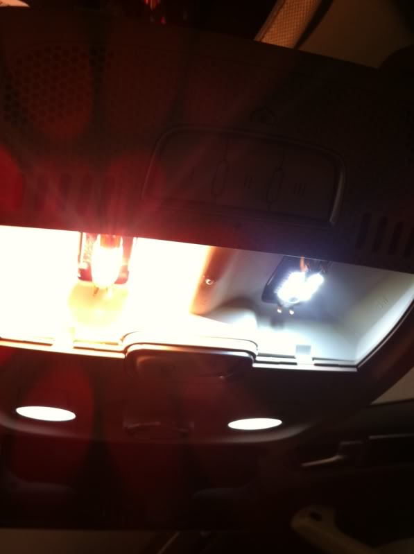 Front dome light LED bulb (right) and factory bulb (left) comparison.
