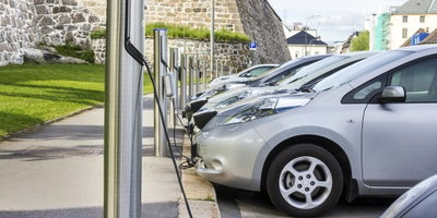 Green, hybrid, electric vehicles at charging station