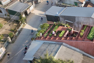 one building in a neighborhood with a terrace garden.