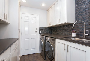 A laundry room with a washing machine.