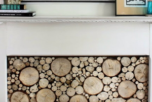 A white fireplace with a wood log insert.