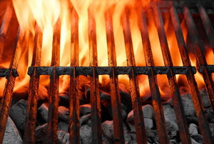 A grill grate with flames blazing from below.