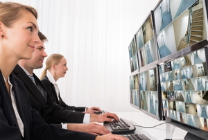 security company staff monitoring camera footage