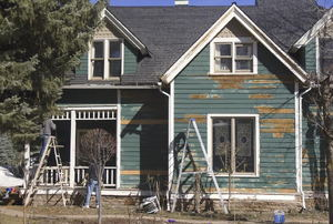 An old house with peeling paint.