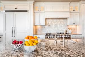 An integrated, or hidden, fridge inside of a new kitchen.