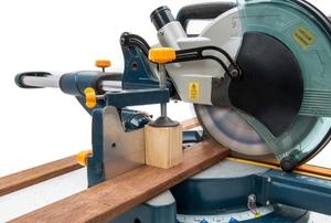 drop down saw cutting long piece of wood