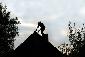 A man on a roof.