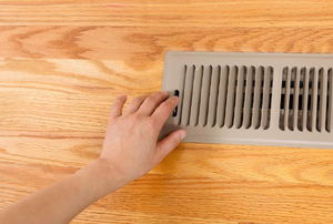 adjusting a floor vent register