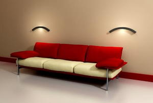 A dark red couch against a cream colored wall.