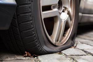 The flat tire on a car