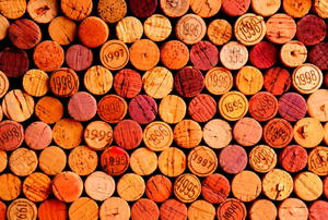 A background of wine corks.