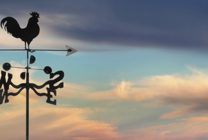 weathervane with cloudy sunset in the background