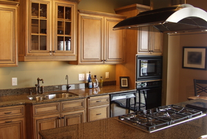 A kitchen with granite counters.