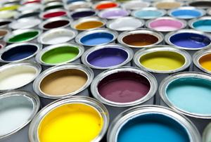 dozens of open paint cans