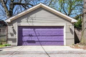A home garage door, painted purple.