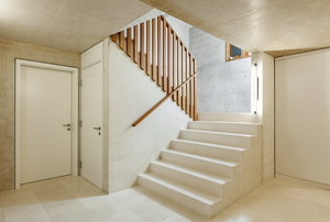 concrete stairs with wooden railing