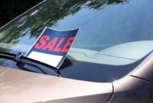 sale sign on a car