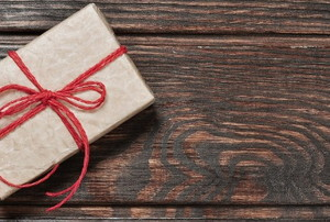 a wrapped gift card on wood