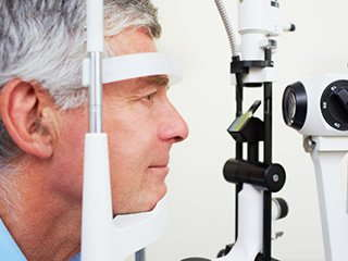 Image of a man getting an eye exam.