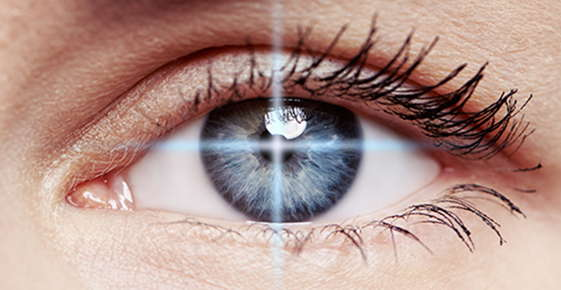 Image of an eye in laser cross hairs.