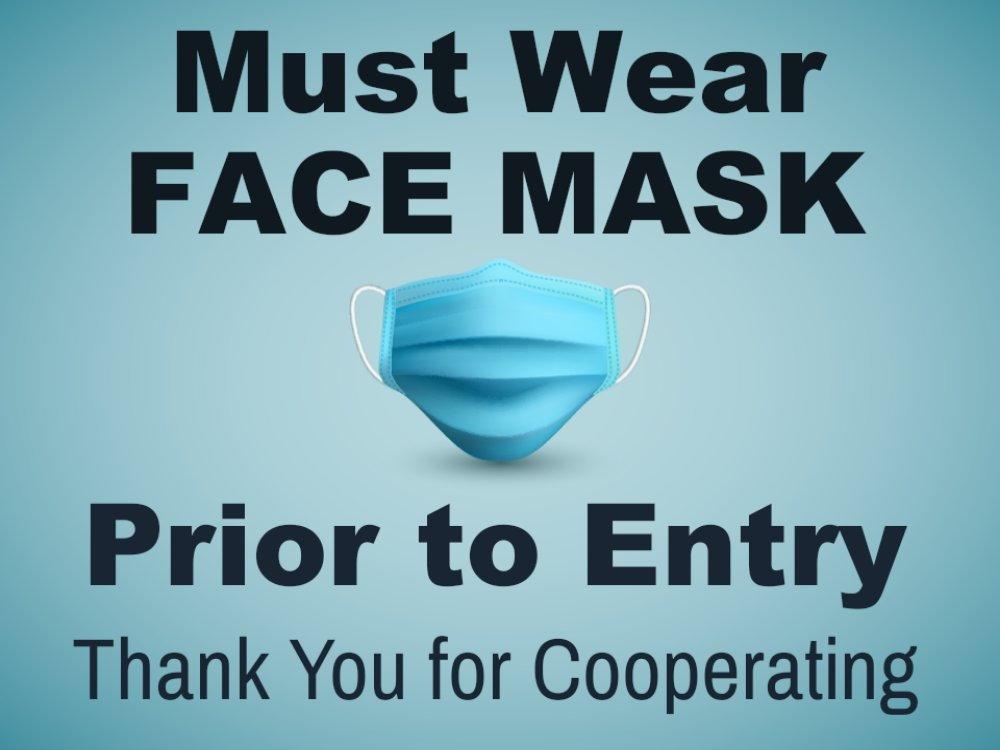 sign stating must wear masks