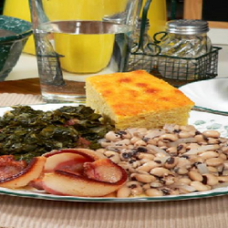 Beans, greens and cornbread on a plate