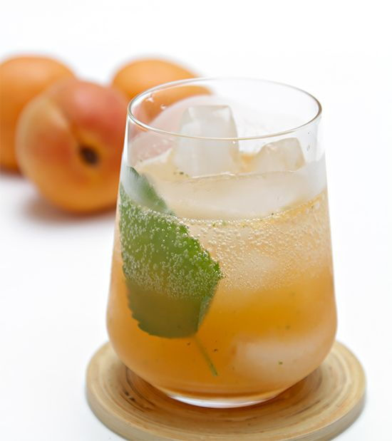 lemon balm and peaches in a cocktail