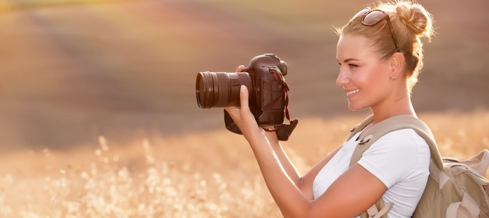 girl with camera outdoors