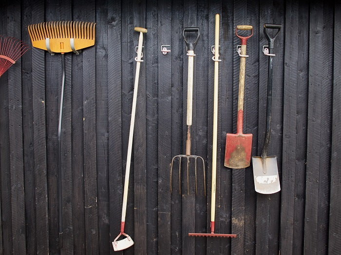 stay organized by hanging up your garden tools