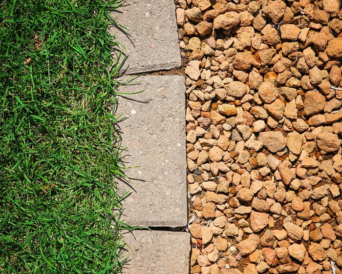 put some decorative stones over your edging to up your home's curb appeal even more