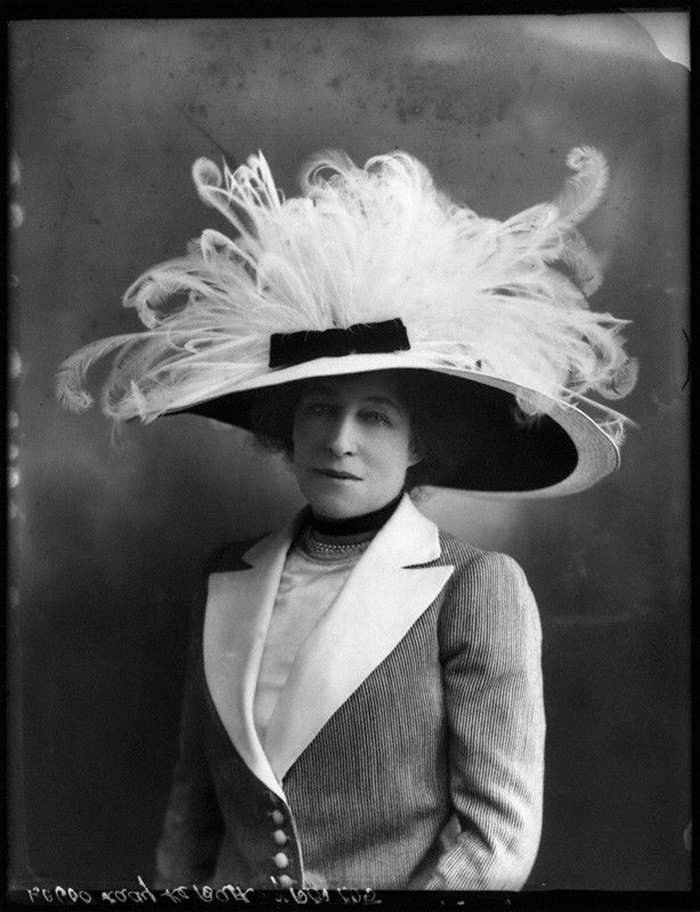 vintage portrait of woman with fluffy feathered hat
