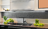 Modern kitchen with metallic look backsplash