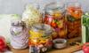 various vegetables pickled in jars